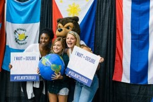 Students pose with Bruiser at Study Abroad Fair.