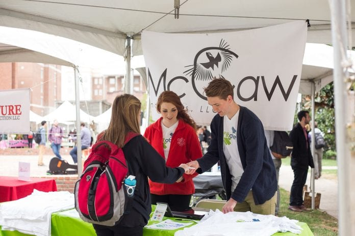 Students promoting their business at a booth on campus