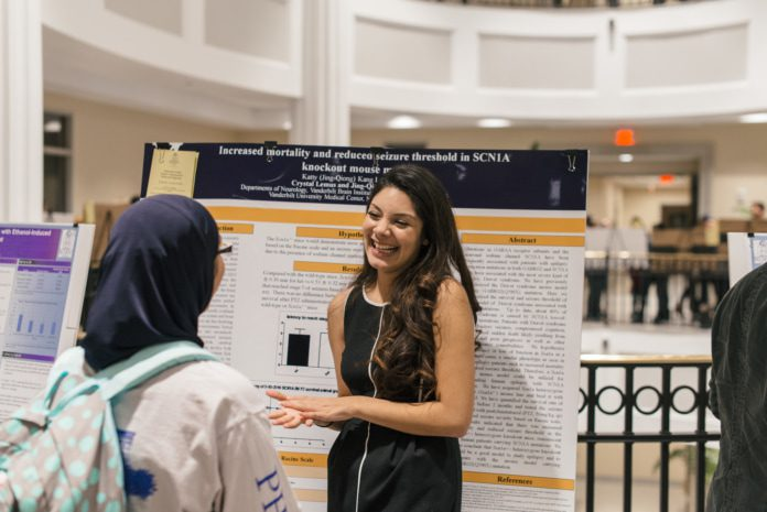 A student presents at this year's science undergraduate research symposium across campus.