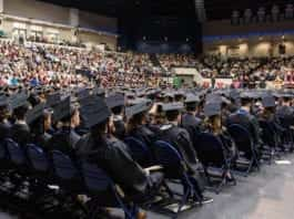 Students in their caps and gowns at Belmont's graduation in the Curb Event Center