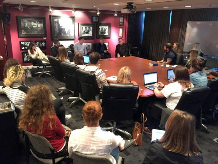 Songwriting students listening to five members of the Capitol Christian Music Group team