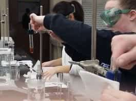 High school students perform science experiments on Belmont's campus.