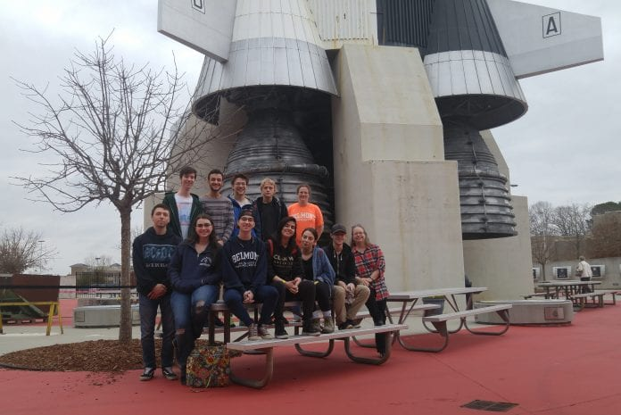 Student pose at the US Space and Rocket Center for a class excursion