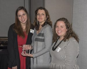 Members of the College of Occupational Therapy holding their award