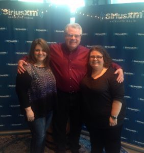 Tina Adair, Curb College, poses with SiriusXM staff.