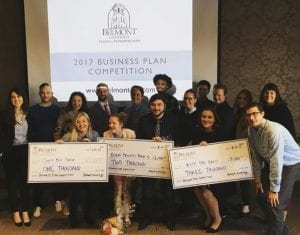 Winners of the Business Plan Competition hold their prizes