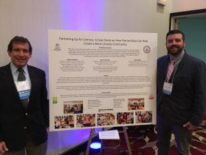 Stewart and Webb with their poster presentation