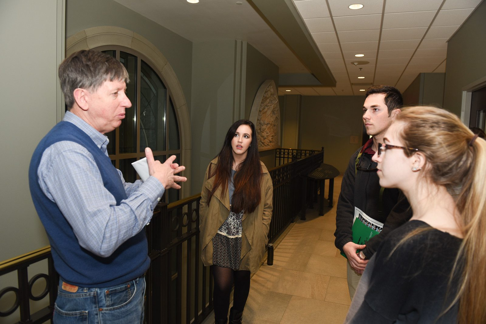 Dr. Davis advises students on their elevator pitches.