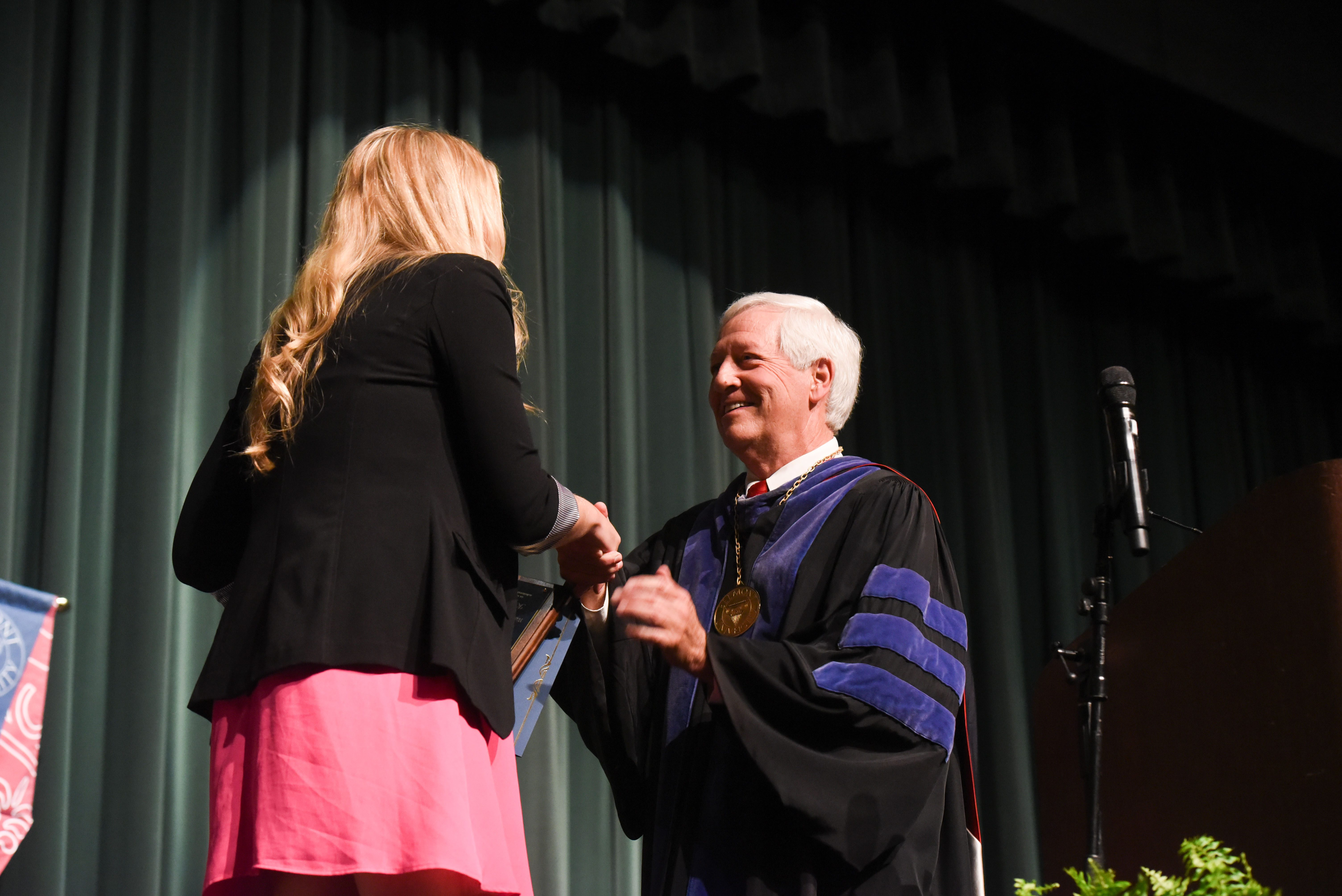 Dr. Fisher presents a student with the Fourth Year Student of the Year Award at the Annual Scholarship and Awards Day