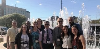Students and faculty pose during their recent trip to present science research at a national conference.