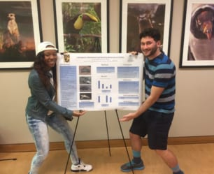 """Students present their """"animal behavior"""" research at the zoo."""