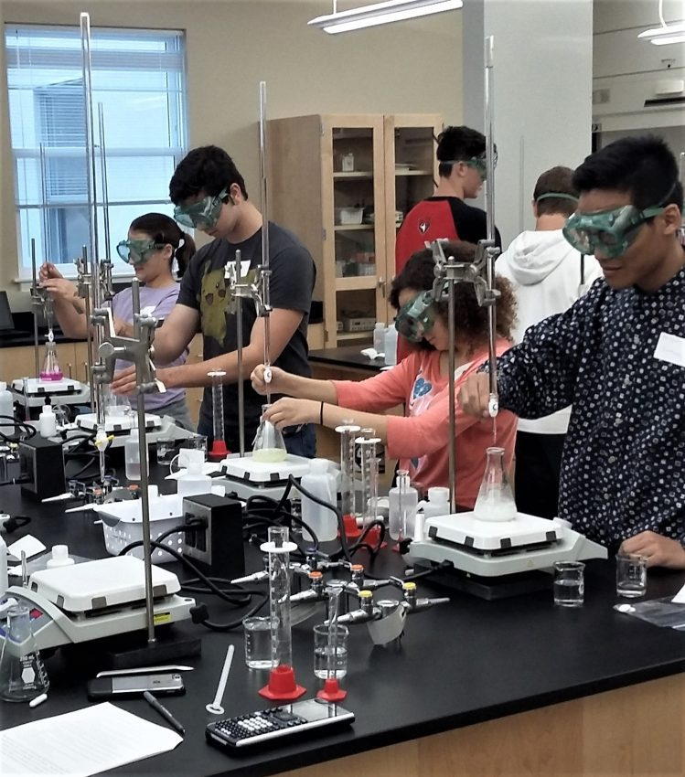 Local high school students participate in a lab at Belmont