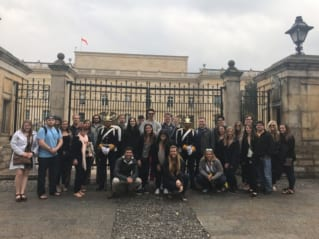 Students pose in front of the Presidential Palace in Bogota, Colombia