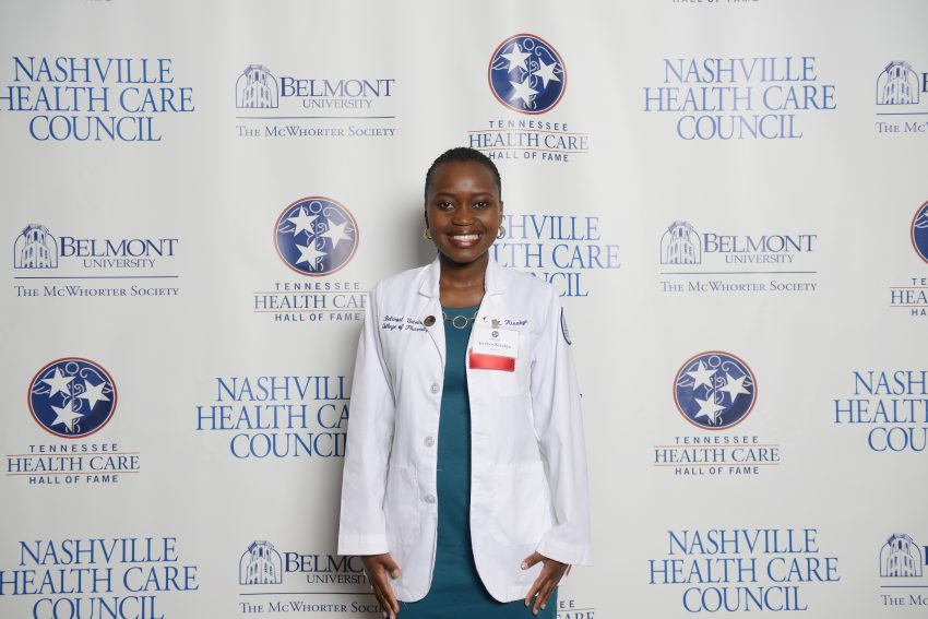 Kisakye, the award recipient, stands in front of a step and repeat at the 2016 Tennessee Health Care Hall of Fame Luncheon