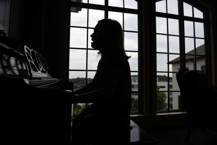 A silhouette image of Falvey performing at Brookside's piano.