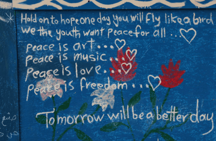 Writing on the wall at a Syrian Refugee Camp
