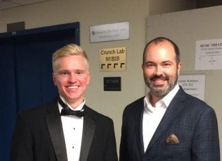 Alex and Mark pose for a picture before one of Alex's performances