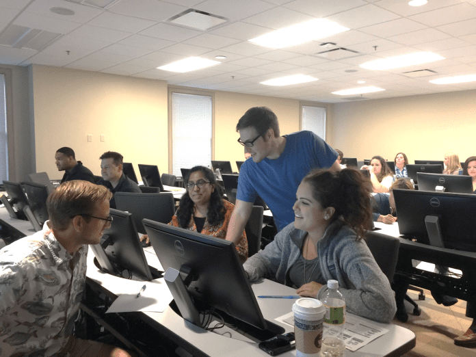 Students participating in SAP-simulated group project represent four disciplines from across campus