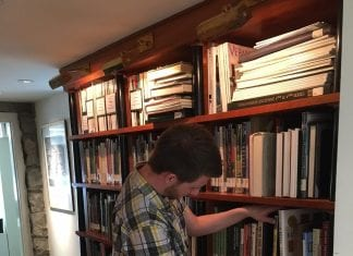A Belmont librarian volunteers his time at a local library.