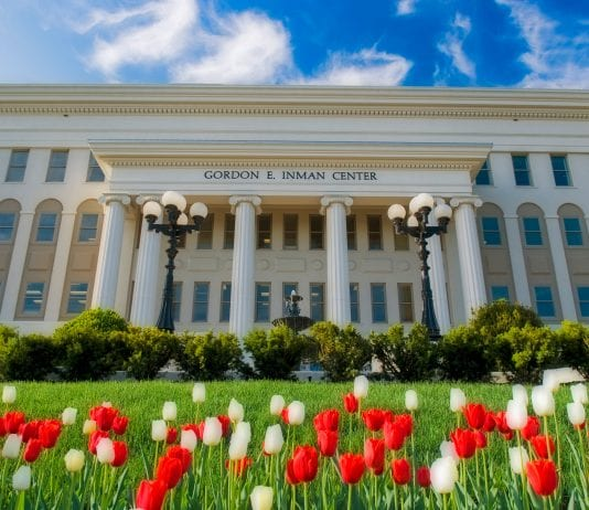 The Gordon E. Inman Health Sciences building on a spring day with tulips in front of the building.