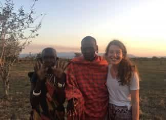 Karah Waters standing with two Tanzanians