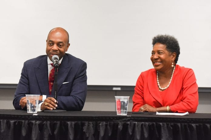 Tennessee Rep. Brenda Gilmore and Rep. Harold Love sitting at a table smiling and answering a question