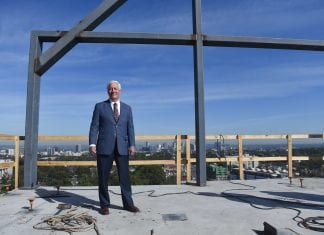 """Dr. Fisher celebrates the """"topping out"""" of the new Hall Hall dorm at Belmont University in Nashville, Tenn. October 20, 2017."""