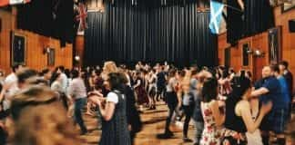 a ceilidh, a big room full of people dancing and eating