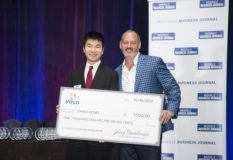 Recipient of the Vaco Accounting Student Scholarship and Belmont University student Yihano Hong, left, receives a check from Jerry Bostelman of Vaco during the Nashville Business Journal's awards dinner recognizing the 2017 CFO Awards finalists.