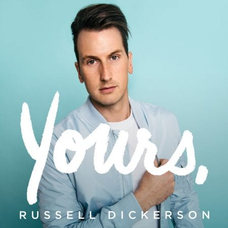 'Yours' album cover - Russel Dickerson in front of blue screen with the word 'Yours' written across the image.