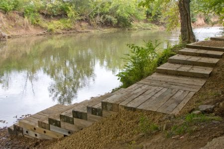 wooden steps leading down to a river