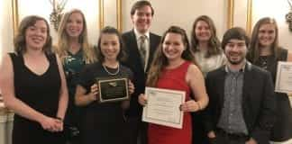 Executive members of PRSSA holding their awards