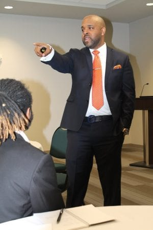 Dr. Thurman Webb, speaking and pointing his hand at the crowd
