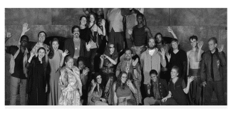 Black and white photo of a group waving at the camera
