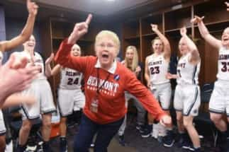 Betty Wiseman cheers with the women's basketball players.