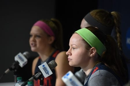 Three Belmont Bruins sit at the Friday afternoon press conference.