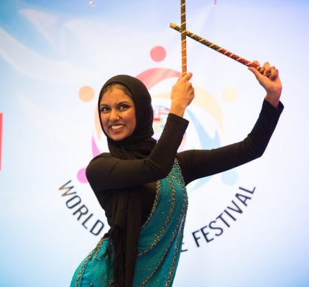 Student performing a cultural dance