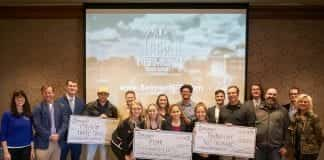 competitors lined up, winners holding their giant checks