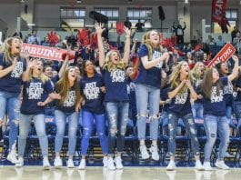 womens basketball team cheering from the sidelines