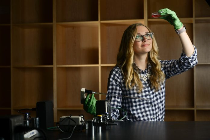 Senior Bailey Bergmann works with cancer cells in an Ayers lab at Belmont University in Nashville, Tennessee, April 6, 2018.