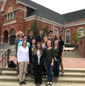 Students and faculty who attended the conference pose for a photo.