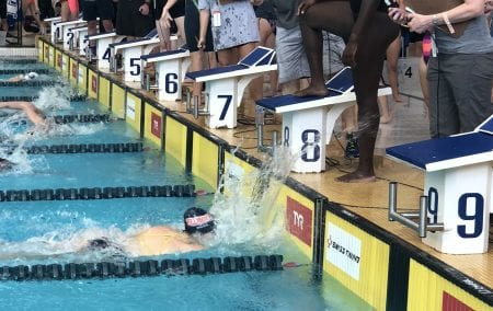 Caylix reaching the finish line in the pool