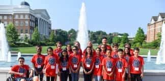 Students pose for a group picture in front of the Belmont fountain.
