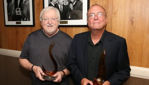 Songwriters Pat Alger and Tony Arata receive Flamekeeper Award.