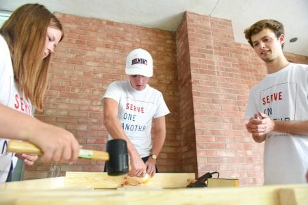 Belmont students use tools to build wooden bed frame for Sweet Sleep at Nashville First Baptist Church in Nashville, Tennessee.