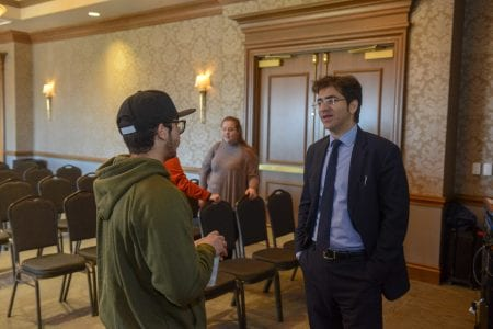 Afshin Molavi speaks with a student
