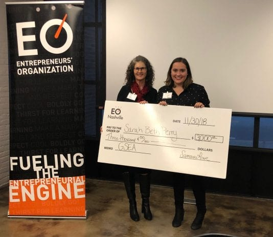 Sarah Beth Perry presented check for winning competition.
