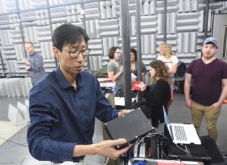 Dr. Doyuen Ko and students work in the anechoic room at Belmont University in Nashville, Tennessee.