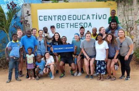 Belmont University students pose with kids in the Dominican Republic