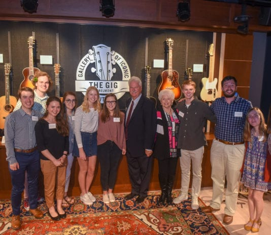 James and Lois Archer pose with current Archer Presidential Scholars.